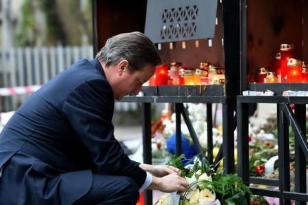 British Prime Minister Cameron lays wreath at Colectiv club premises